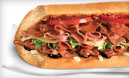 Sandwiches, Salads, Chips, and Drinks at Quiznos (Half Off). Two Options Available.