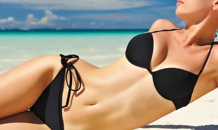One Month of Unlimited UV Tanning in a Level-One Bed or Three VersaSpa Spray Tans at Naked Tan (Up to 76% Off)