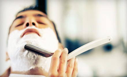 One or Three Men's Haircuts with Beard Trims or Men's Haircut with Hot-Towel Shave at Anvil Barber Shop (Up to 61% Off)