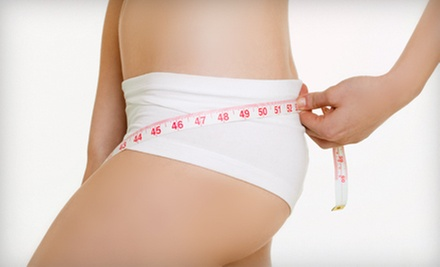 One, Three, or Six Slimming Fit Body-Wrap Sessions at The Sun Oasis Tanning Center in Auburn Hills (Up to 70% Off