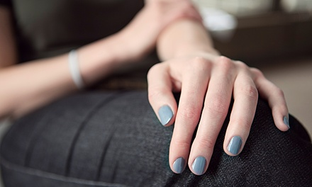 One or Two Mani-Pedis at Infinite Tan & Spa (Up to 51% Off)