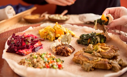 Ethiopian Meal for Two or Four with Appetizers, Entrees, and Dessert at Axum Restaurant (Up to Half Off)