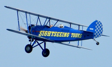 $79 for a 15-Minute Open Cockpit Biplane Ride for Up to Two from Sky High Air Tours ($150 Value)