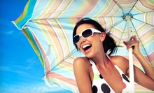 One or Three Custom Airbrush Tans, or One Month of Unlimited Gold Tanning at Island Tan Salon (Up to 67% Off)
