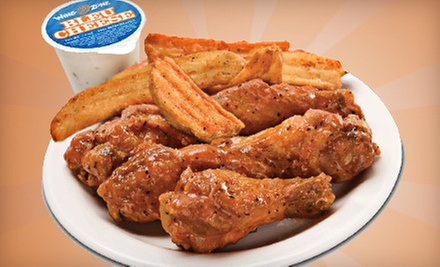 Wings, Sandwiches, and Burgers at Wing Zone (Half Off). Two Options Available.