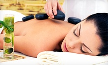 One or Four 60-Minute Swedish or Deep-Tissue Massages with Hot Stones at Conchita Bodyworkz (Half Off)