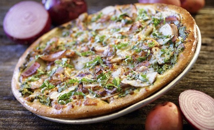$11 for a Large Specialty or 3-Topping Pizza with an Order of Twisted Sticks at Extreme Pizza (Up to $22.15 Value)