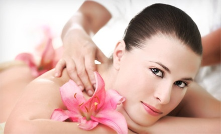 Choice of Massage or Facial, Couples Massage, or Mani-Pedi at Solaire Hair Studio and Spa (Up to 57% Off)