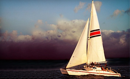 Sunset Cruise for an Adult or Child from North Shore Catamaran Charters (Up to 59% Off)