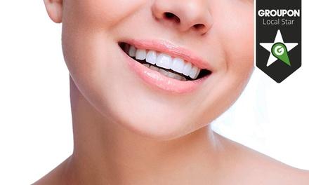 Clínica Dentária de Algés — Algés: consulta de higiene oral com destartarização e opção de branqueamento LED desde 16€