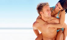 One Month of Tanning or Two Spray Tans, or Two Months of Tanning or Four Spray Tans at SunTanz Tanning (Up to 61% Off)