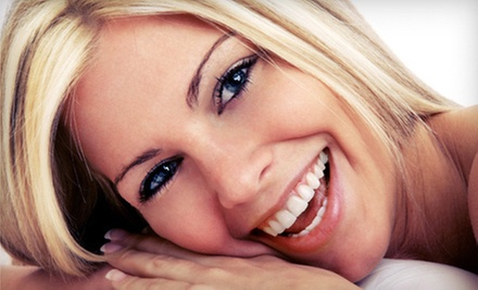 $39 for an Initial Exam, X-rays, and Cleaning at Ultimate Dental ($320 Value)