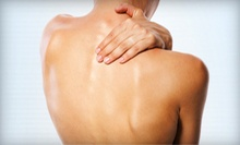 Chiropractic Exam and Two or Four Adjustments or a 60-Minute Massage at Preferred Chiropractic Center (Up to 89% Off)