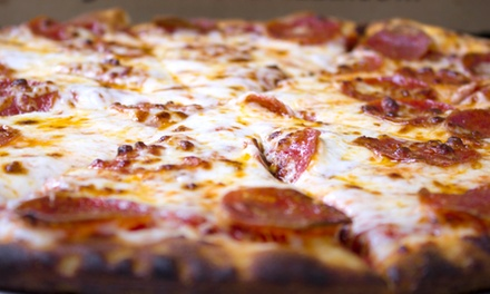 Pizza and Wings for Carry Out or Delivery at Pudge Brothers Pizza (Up to 40% Off). Three Options Available.