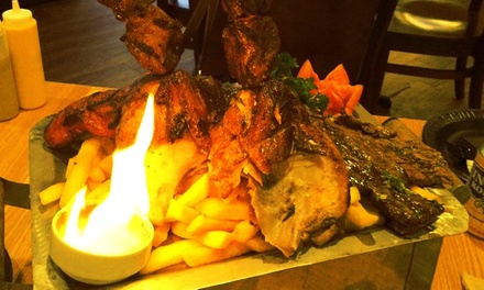 $12 for Four Groupons, Each Good for $5 Worth of Peruvian Food at Aromas a la Brasa ($20 Total Value)