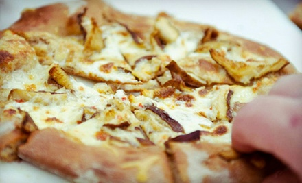 Locally Sourced Pizzas, Salads, and Sandwiches for Dinner for Two or Four at Pure Pizza (Half Off)