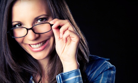 $35 for an Optometry Package with Eye Exam and $225 Toward Lenses and Frames at Happy Eyes Optometry ($310 Value)
