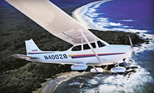 Introductory Flight Lesson or Flight Package with Ground Training and Flying Time from Wings Aloft BFI (Half Off)