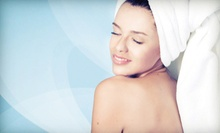 60-Minute Massage with Leg-Firming Treatment, Facial with Eye Quattro, or Both at Touch Institute (Up to 61% Off)
