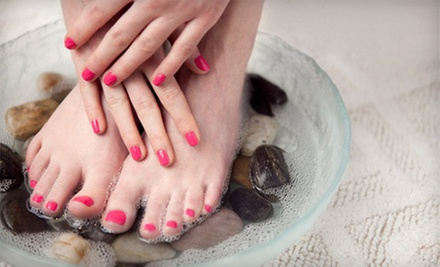 Spa Pedicure or Spa Mani-Pedi at Club Beauty (Up to 53% Off)