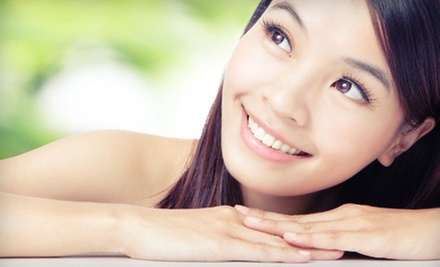 Glycolic Peel, Parisian Facial, or Super Antioxidant Facial at Qi Spa (Up to 55% Off)