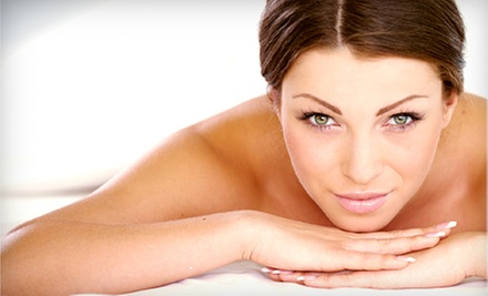 Massage, Facial and Seaweed Wrap, or Spa Pedicure and Seaweed Wrap at Pure Radiance Spa Salon & Tanning (Half Off)