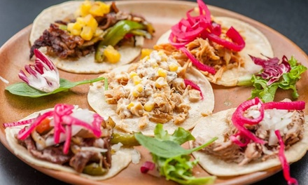 $29 for Tequila Tasting for Two with Tequila Pours and Appetizers at Calle Tacos & Tequila (Up to 56% Off)