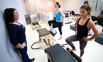 10 Group Fitness Classes or 5 Private or Semiprivate Pilates Sessions at COR  (Up to 73% Off)