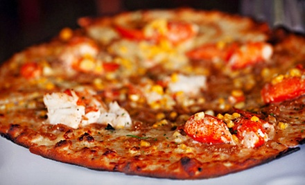 $19 for a Pizza Dinner with Pizzas and Salad for Two at The Fireplace Room at The International (Up to $42 Value)