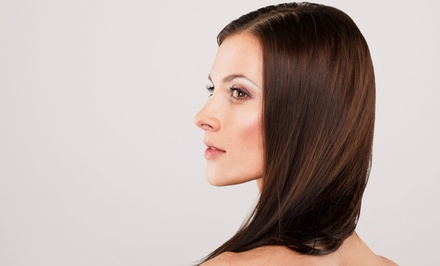 Haircut with Optional Highlights, or Smoothing Treatment at Salon Envy (Up to 68% Off)