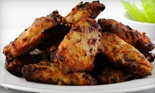American Food and Drinks for Two or Four at Island Sports Bar & Grill (Up to 56% Off)