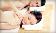 One or Two 60-Minute Massages or One 60-Minute Couples Massage with Champagne at Atmosphere Essentials (Up to 69% Off)