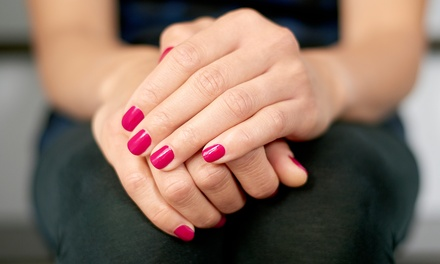 Two Gel Manicures or One Waterless Pedicure at S.P.A. Exclusive (Up to 42% Off)