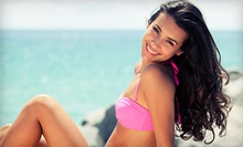 One Month of Unlimited UV Tanning with Option for Three Spray Tans, or Five Spray Tans at Tropical Tan (Up to 73% Off)