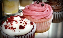 One or Two Dozen Jumbo Cupcakes at Sugar and Spice Bakery (Up to 55% Off)