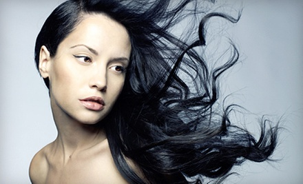 Haircut and Style with Conditioning Treatment, Relaxer, or Partial Weave at Salon 50 (Up to 64% Off)