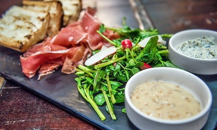 Steak and Seafood Dinner Cuisine for Two or Four at The Gryphon (Up to 41% Off). Groupon Reservation Required.