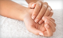 Manicure or Mani-Pedi with Hot Oil and Hot Towels at The Best Nails and Massage (Up to 52% Off)