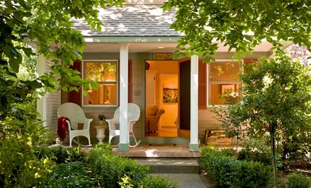 groupon daily deal - 1- or 2-Night Stay for Two with Wine, Resort Credit, and Optional Massage at Cottage Grove Inn in Napa Valley, CA