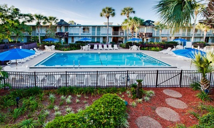 groupon daily deal - 7-Night Stay for Four in a One-Bedroom Suite at Magic Tree in Kissimmee, FL. Combine Up to 14 Nights.
