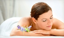 $55 for a Spa Package with Massage, Facial, Pedicure, and Paraffin Hand Treatment at Flourish Salon &amp; Spa ($135 Value)