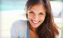 Dental Exam, Cleaning, and X-rays or Zoom! Teeth Whitening at Cosmetic &amp; Implant Dentistry of Maryland (Up to 77% Off)