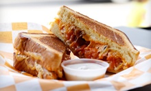 $10 for $20 Worth of Gourmet Grilled Cheese Sandwiches, Soups, and Drinks at Cheesie's Pub & Grub