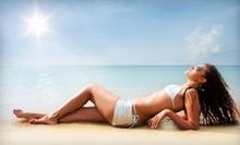 One or Two Airbrush Tans or One Month of Unlimited Level 2 UV Tanning at Nola Salon & Tan (Up to 59% Off)