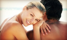 2 or 5 Mystic Spray Tans, or 5 or 10 Level 2 or 3 UV Sessions at Bahama Breeze Tanning Salon (Up to 69% Off)