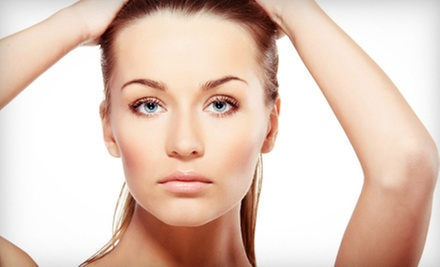 One or Two Fraxel Laser Treatments for the Face at LaserTouch Aesthetics (83% Off)
