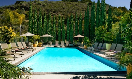 groupon daily deal - Stay at Days Hotel San Diego Hotel Circle/Near SeaWorld, with Dates into May