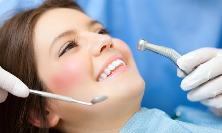 $40 for a Dental Checkup with Cleaning, X-rays, and Exam at Dental Implant Institute ($295 Value)