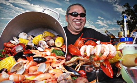 $25 for $50 Worth of Steak, Seafood, Hurricanes, and Other Drinks at Poppy's Crazy Lobster Bar and Grill