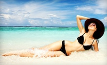 One Month of Unlimited UV Tanning or Three Airbrush Tans at Tanning Oasis (Up to 79% Off)